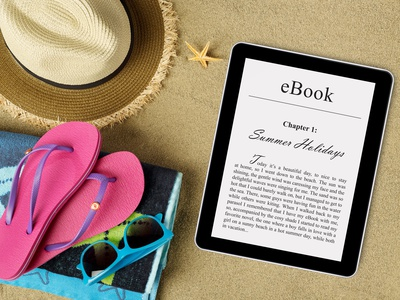 eBook reader, beach accessories on sand